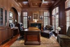 richly appointed home office and den with large dark wood furniture extensive wood paneling antique home office furniture fine