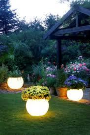 garden outdoor lighting tips ideas outdoor lamp glowing flower pots amazing garden lighting flower