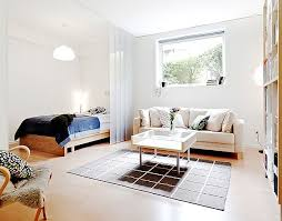 living room with bed:  images about bedroom living room combo on pinterest studios minimal design and studio apartments