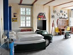 classic car themed bedroom design with automotive wall decorations and furniture car themed bedroom furniture