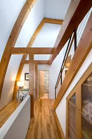 photos hgtv hallway in a modern home with exposed wood beams on the ceilings and walls architecture architectural mirrored furniture design