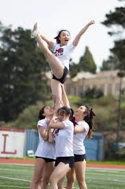 photos students get spirited at the spring rally lowell cheerleaders hold up flier junior alisha tam photo by jennifer cheung