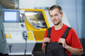 co career action tools molding machine operator shutterstock 126737450