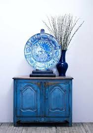 gorgeous blue chest and love the oversized platter with one vase asymetrical at its best blue furniture
