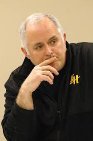 Kenowa Hills School Board President Frank Hammond listens to the debate as ... - 9433919-large