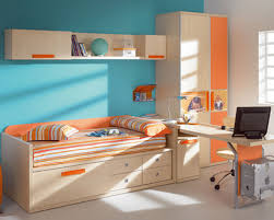 blue kids room interior design with study desk and swivel chair with blue wall theme modern kids room and storage organization with blue table lamp blue themed boy kids bedroom