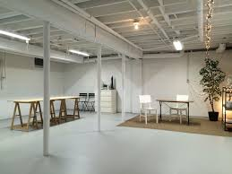 art studio in semi finished basement spray paint ceiling white basement office setup 3 primary