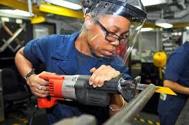 u s department of defense photo essay u s navy seaman yoasha wood cuts a piece of metal aboard the aircraft carrier uss ronald