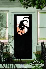 love halloween window decor: make your own halloween door decorations with vinyl a spooky oogie boogie silhouette is the