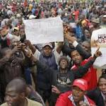 Thousands march in Zimbabwe to demand Mugabe step down after 37 years in power