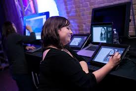 new degree options in ut s college of fine arts designed to a student draws on a tablet at the launch event for the center for arts and