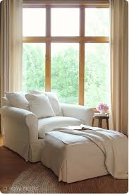 this nook in the master bedroom is gorgeous i love the cream colored chair and ottoman it looks super comfy i also love the paint color on the woodwork bedroomalluring members mark leather executive chair