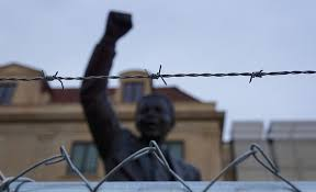 the violence of nonviolent protest    new internationalist  essay opposing mindless nonviolence statue of mandela related image