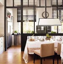 white kitchen windowed partition wall: delounder designs semi combined kitchen and dining areas separated by glass partition wall