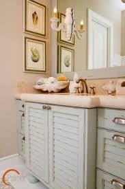 coastal bathroom designs: beach style bathroom with light blue vintage bathroom cabinet ideas also beige marble contertop also modern faucet and mixer tap also modern mirror design