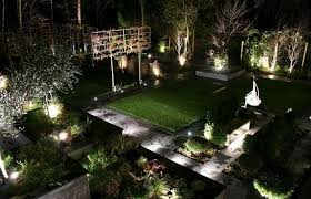 awesome landscape lighting idea feat green lawn and topiaries design plus modern raised garden awesome modern landscape lighting design