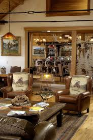 rustic style living room clever: rustic western ranch home love the cowboy chairs and the antler chandeliers
