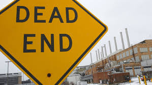 why people don t give up on unfulfilling dead end jobs quartz a dead end sign is seen at the mostly unused kodak factory in rochester