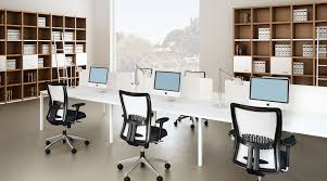 long white computer desk and comfy swivel chairs in spacious office interior design bright office room interior