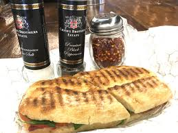 paninis jpg resulting in a crisp smoky crust pizzas range from 10 to 17 other items include bruschetta calzones desserts beer and wine