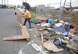 prior to starting a new home gregory goes hunting for raw materials by digging through dumpsters in an industrial area of oakland artist creates mobile homes