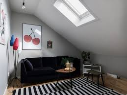 attic living room design youtube: view in gallery attic living room with a small coffee table but roomy sofa