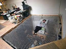 file this under cool beds for geeks located inside an actual office this bed was designed to look like a giant net or spiderweb overlooking the bottom bed for office