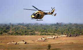 u s  department of defense  photo essay     an indian army helicopter flies over a field   both soviet and u s  military combat vehicles