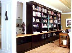 built in bookcasestorage wall with desk area and file drawers ebonized wood with bookshelf file storage wall