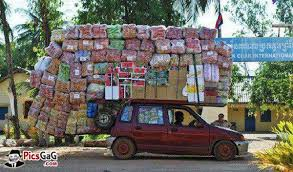 Image result for pics of an overloaded truck