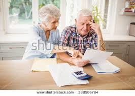 Image result for images elderly couple looking at bills