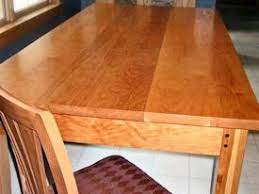 walnut cherry dining: custom cherry shaker style dining table with drawer and walnut accents on legs