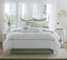 monochromatic white bedroom with decorative green beach theme plus brown rug also lantern lighting beach theme lighting