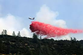 u s department of defense photo essay a cal fire aircraft drops fire retardant on a hilltop east of clearlake calif