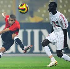 essay globalization and the beautiful game welt s mohamed zidan l kicks a ball past sudan s yousif alaeldin during the