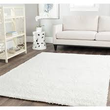 charming square shag rugs in white on wooden floor plus white sofa and antique white rack charming shag rugs