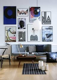 living room wall white decoratef with frames and grey sofa