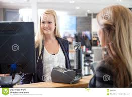 receptionist helping customer at beauty salon stock photography receptionist helping customer at beauty salon