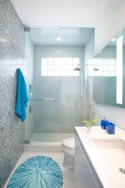 small bathroom clock: small bathroom designs with walk in shower glass door and blue mat and towes and narrow layout best small bathroom designs small bathroom design ideas