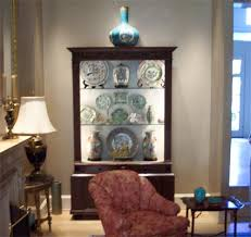 antique reproduction cabinets with glass panel doors can be a challenge to cabinet lighting custom