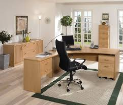 captivating office design presented with plain black curvy back chair facing soft brown pine desks for home office which has several wooden drawers amazing office table chairs