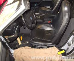 cover seat rail with a fender cover yellow arrow then open the convertible top with the top open grab the seat back at the bottom between the back and bmw z3 seat rail bushing