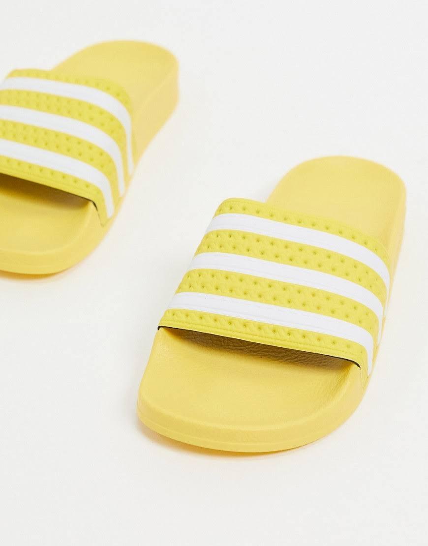 Adidas Originals Adilette Sliders in Yellow-White